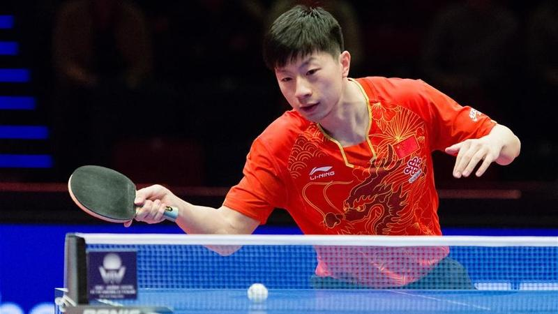 Ma Long becomes first man to win four Olympic table tennis golds