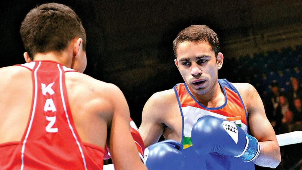 World No. 1 Amit Panghal exits out of Tokyo Olympics boxing at first hurdle. Amit lost to Colombia's Yuberjen Martinez by a 1:4 margin   SportzPoint   Boxing